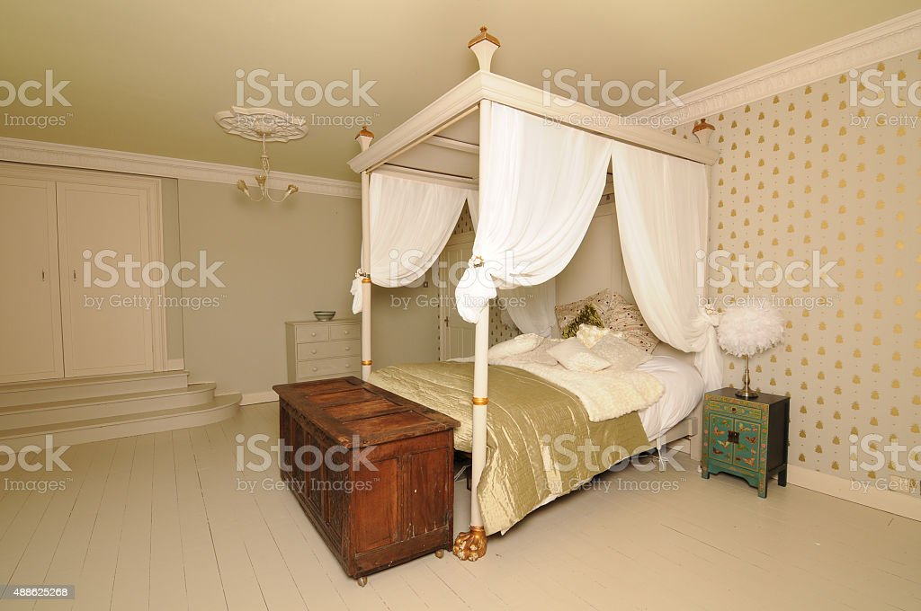 four-poster bed (four poster) stock photo