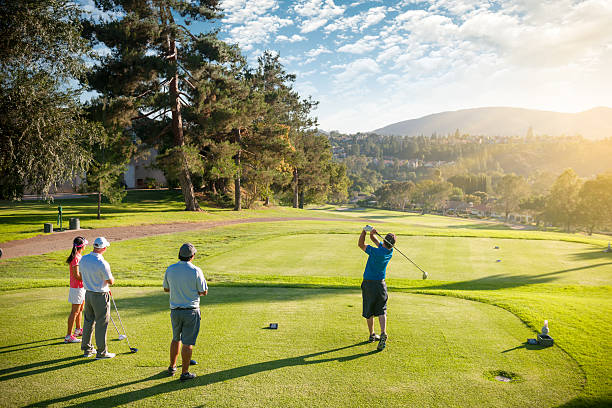 foursome of golfers - golf stock photos and pictures