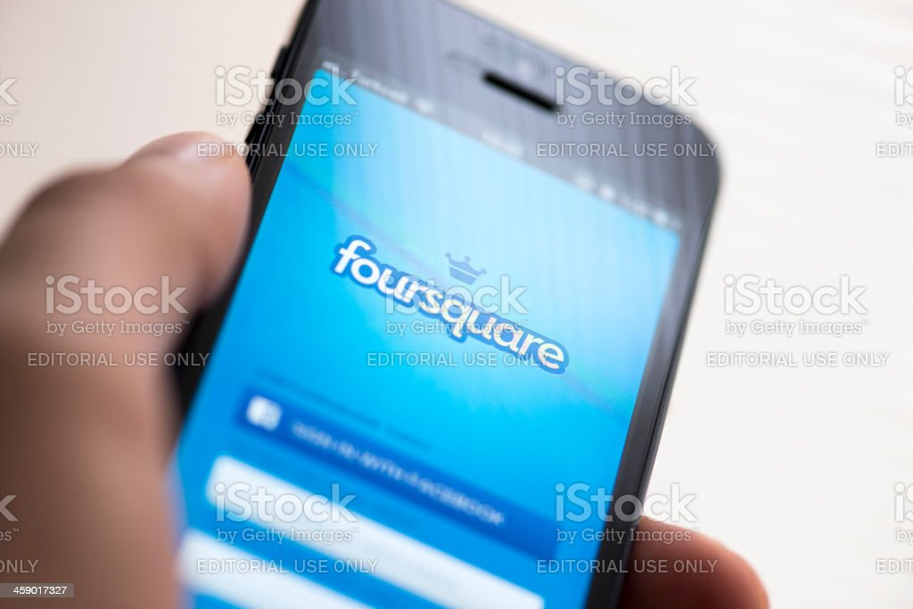 Foursquare app on Apple iPhone 5 royalty-free stock photo