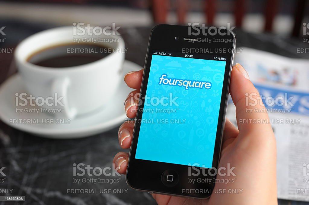 Foursquare on iPhone 4 royalty-free stock photo
