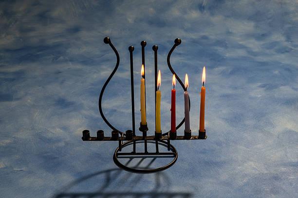 Fourth day of Hanukkah with burning Hanukkah candles in Menorah Fourth day of Hanukkah with burning Hanukkah candles in Menorah day 4 stock pictures, royalty-free photos & images