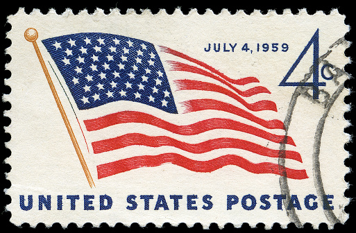 Four Cent Fourth of July 1959 Stamp - on this date a 49th star was added to the American flag to represent the new state of Alaska. The stamp is discoloured due to age