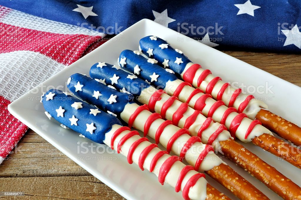 Fourth of July American flag pretzel rods on plate stock photo