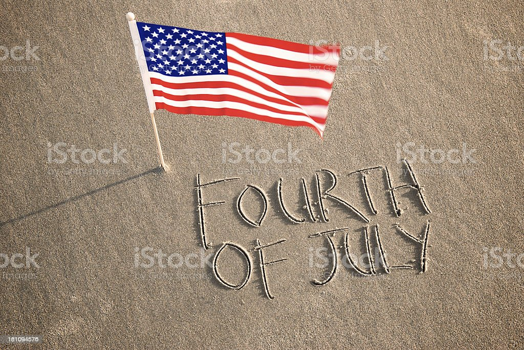 Fourth of July Beach Message with Flag stock photo