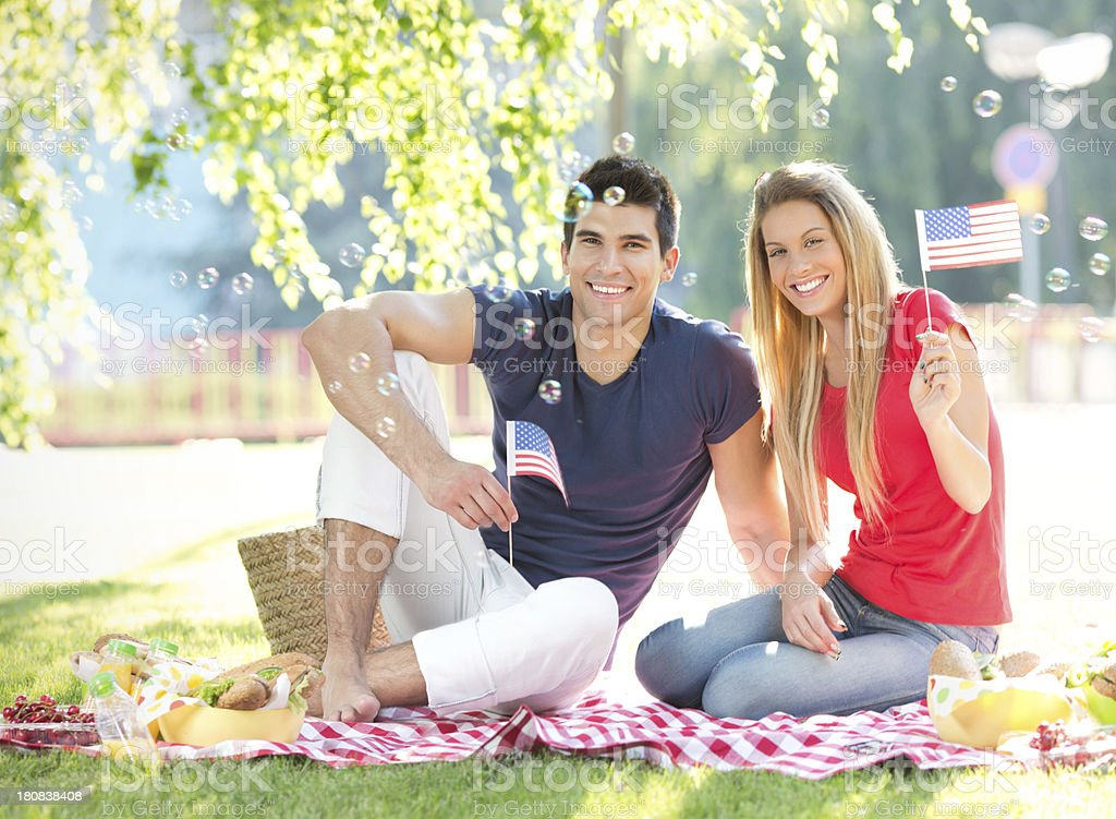 Fourth of July couple picnic. stock photo