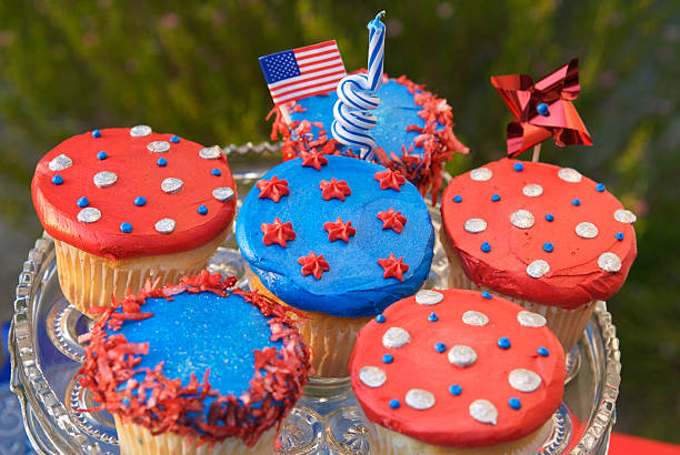 Fourth of July Cupcakes, American Flag on Patriotic Picnic Cake stock photo
