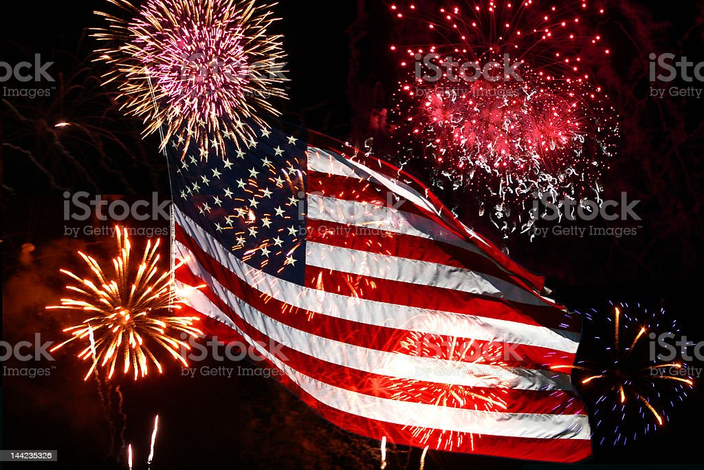 Fourth of July Fireworks and American Flag stock photo