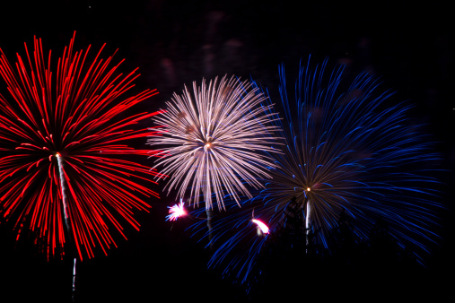 A red, white and blue fireworks display on Fourth of July in Lake Tahoe, California.