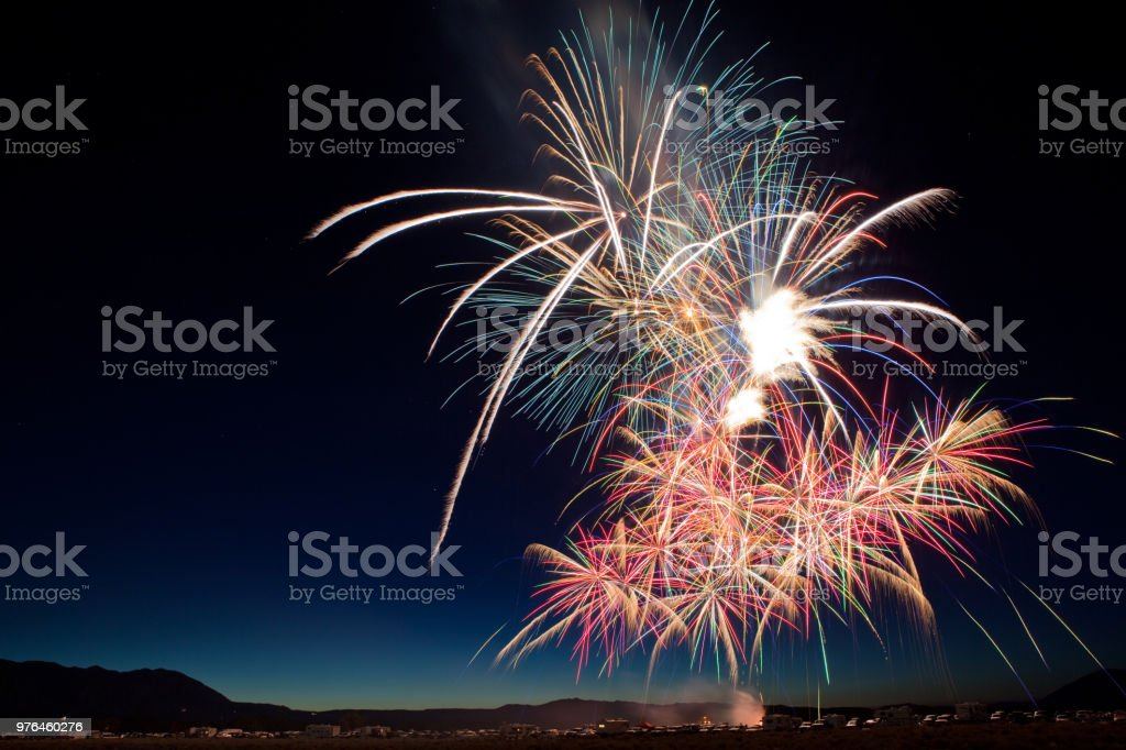Fourth of July Fireworks Show in California Many colorful fireworks bursts for a July 4th celebration in Eastern California. Anniversary Stock Photo