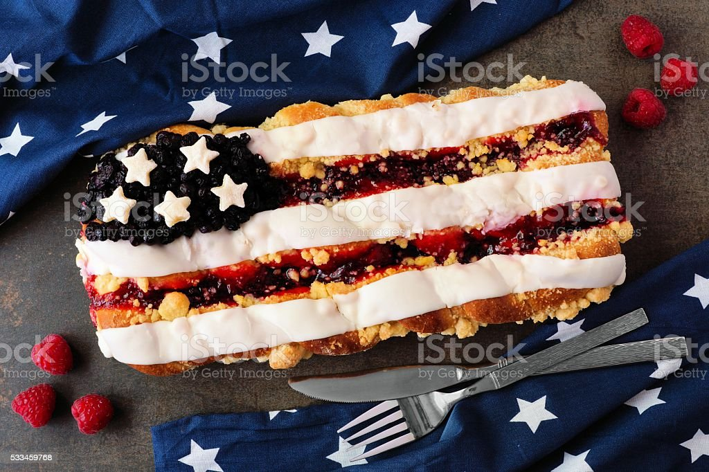 Fourth of July flag pastry with holiday decor on stone stock photo
