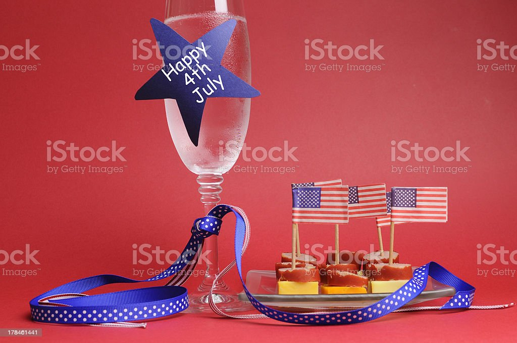 Fourth of July party champagne glass and cocktail food. stock photo