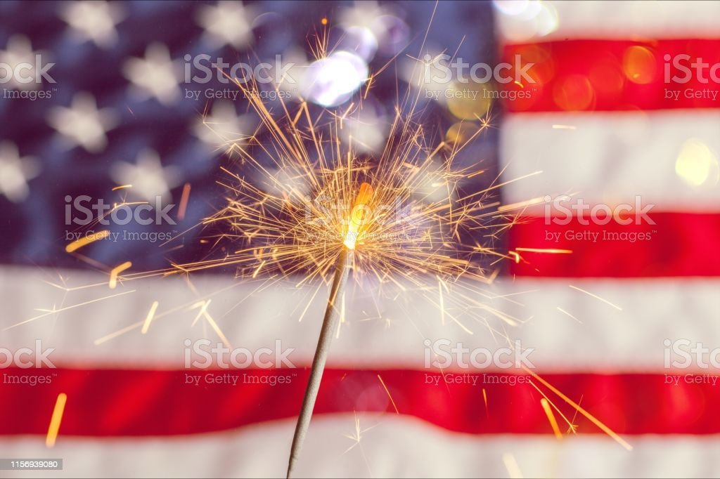 Fourth of july. Sparkler and usa flag showing 4th of july American Flag Stock Photo