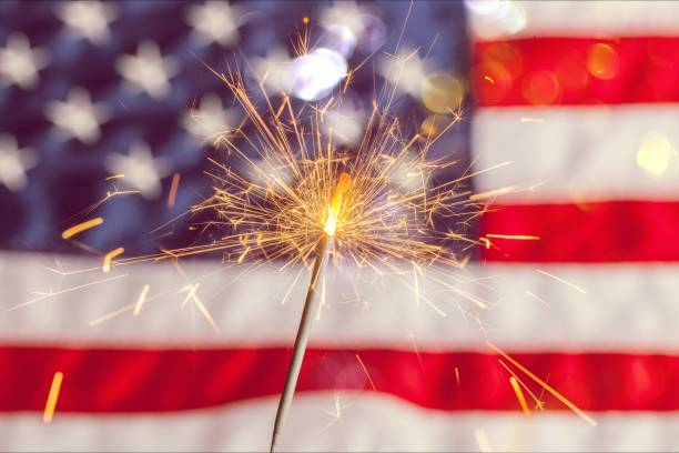 Fourth of july. Sparkler and usa flag showing 4th of july independence day photos stock pictures, royalty-free photos & images