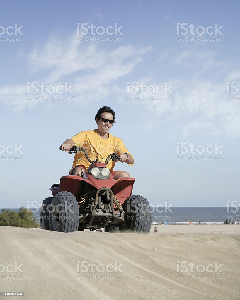 Fourwheeler in the sand stock photo
