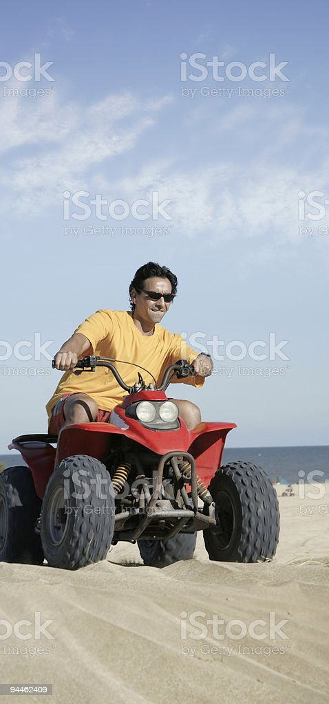 Fourwheeler in the sand stock photo