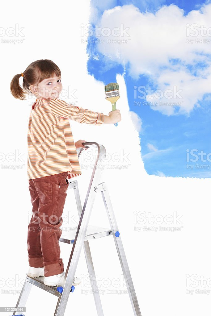 four-year girl  on  ladder and draws  picture. royalty-free stock photo