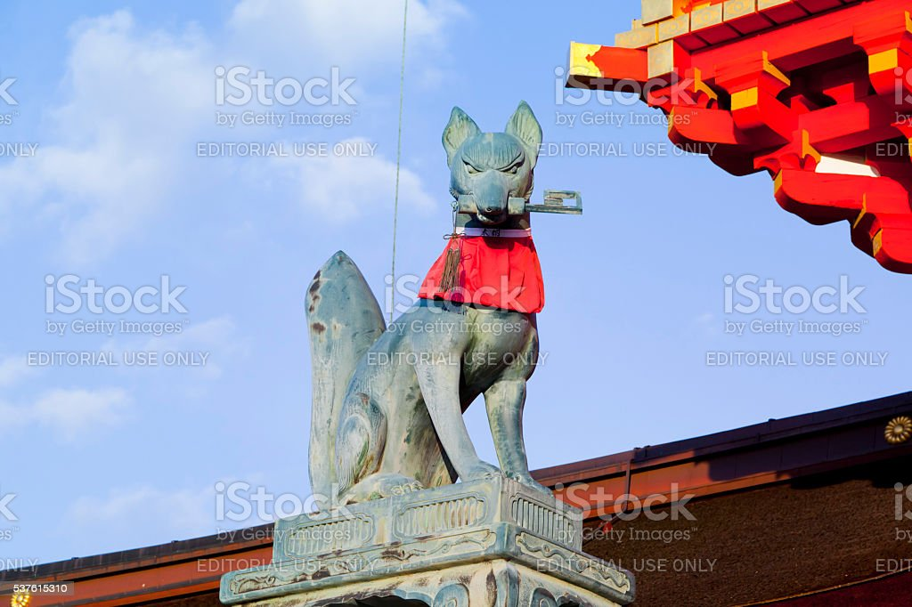 Fox statue at the Fushimi Inari Shrine in Kyoto,Japan. stock photo