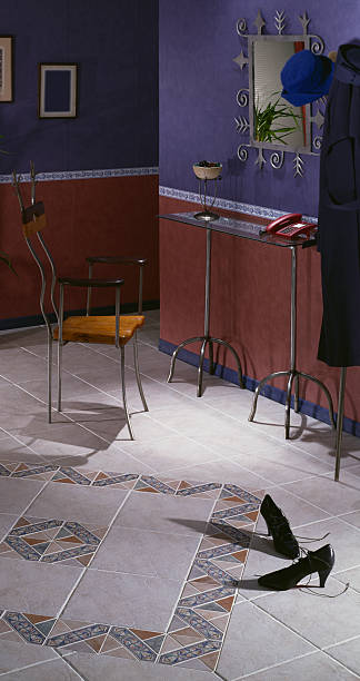 Foyer Detail Tiled foyer with a pair of high-heel shoes left behind grifare stock pictures, royalty-free photos & images