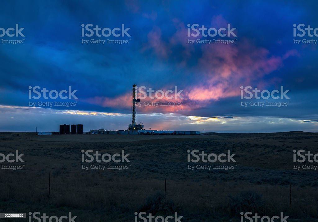 Fracking Drill Rig at Sunset stock photo