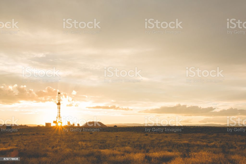 Fracking Drilling Rig at the Golden Hour stock photo