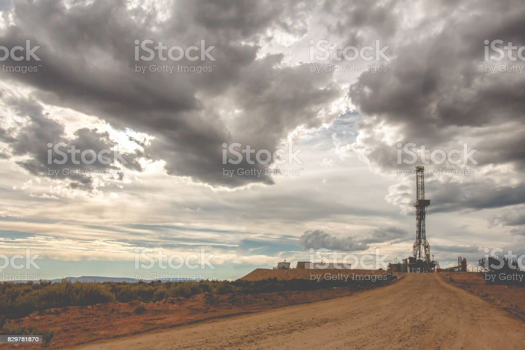 Fracking Drilling Rig Under a Dramatic Cloudy Sky stock photo