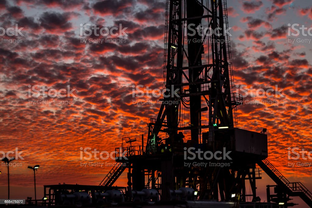 Fracking Rig at summer sunset stock photo