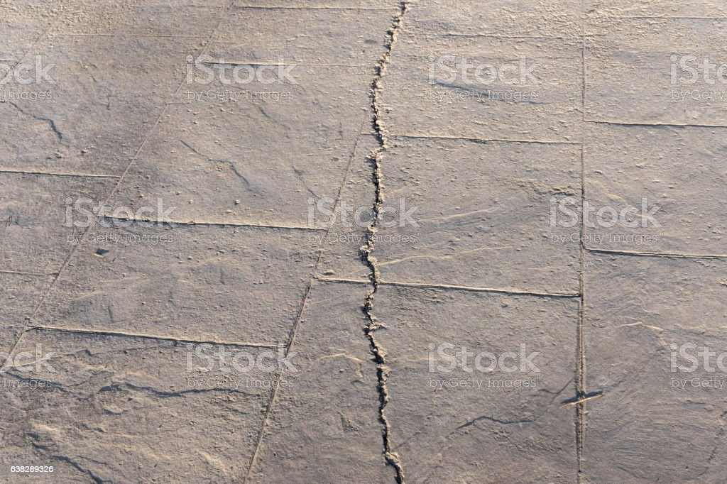 fractured stamped concrete pavement outdoor, appearance colors and textures of stock photo