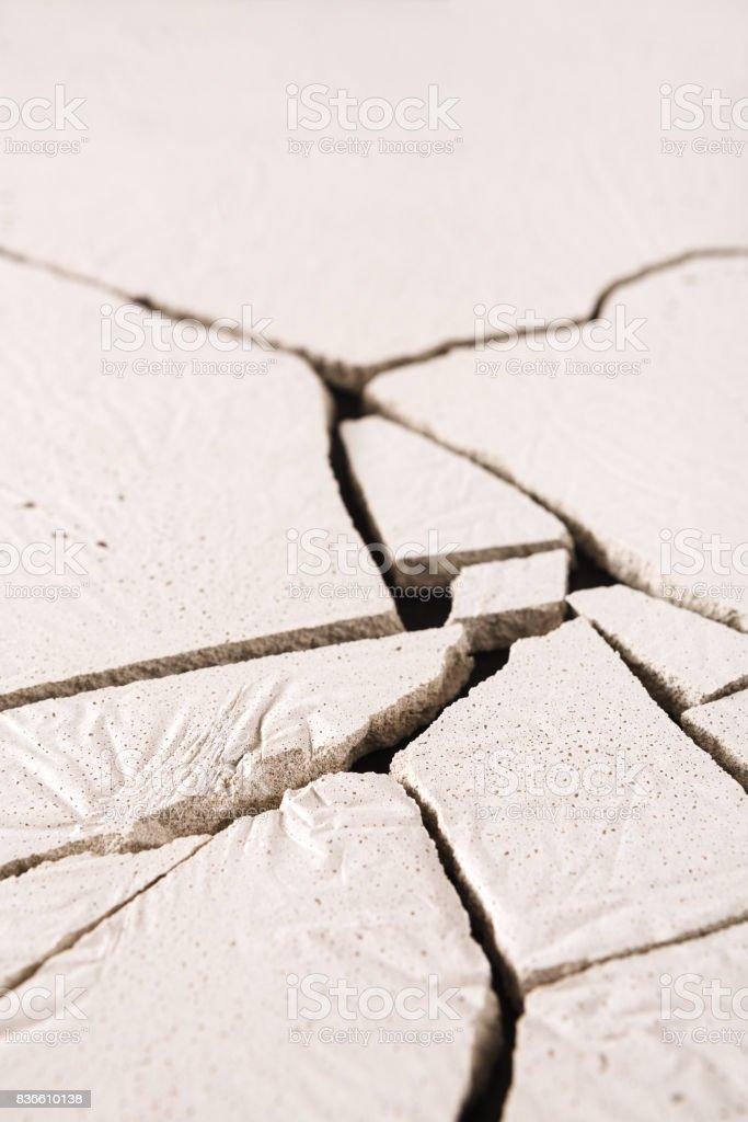 Fractured white concrete background stock photo
