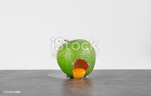 different tham it seems. OUtside a green apple, inside a raw egg