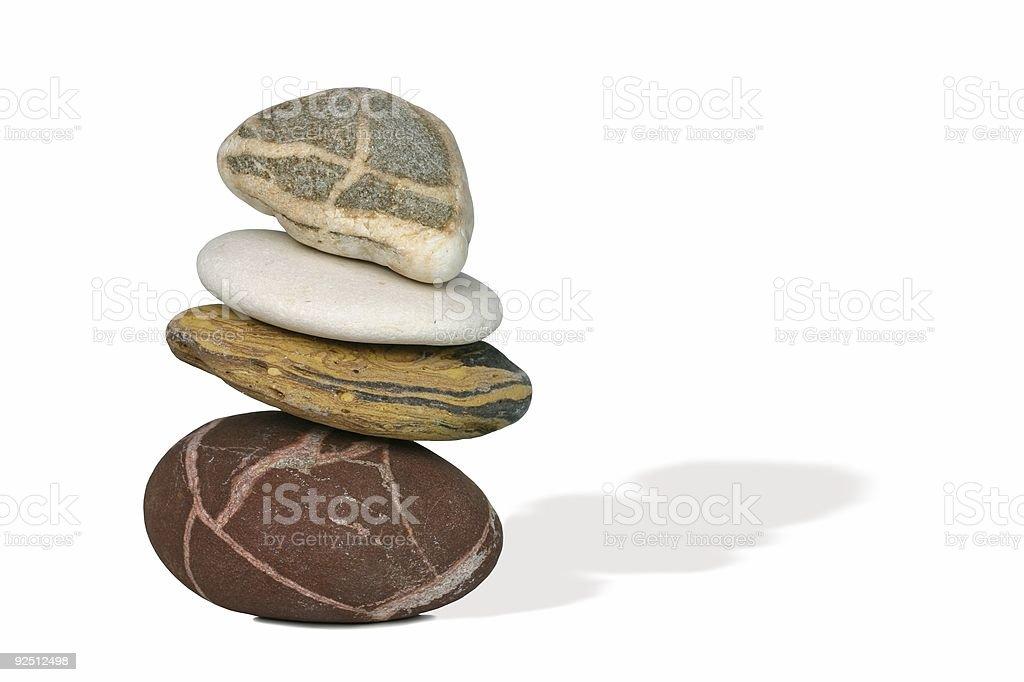 fragile balancing act metaphor on textured pebbles royalty-free stock photo