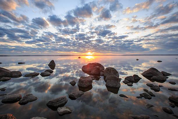 fragile beauty of the moment of sunrise stock photo