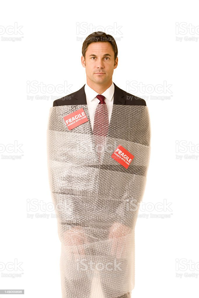 Fragile businessman stock photo