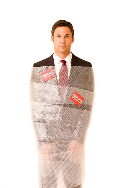 Fragile businessman stock photo