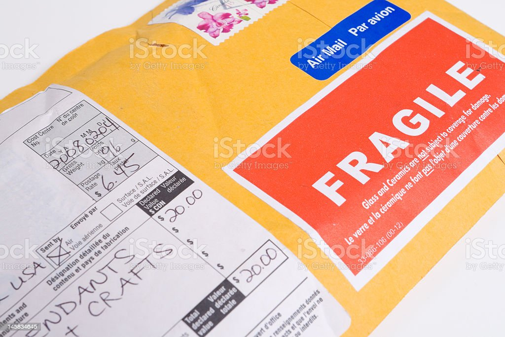 Fragile Canadian Airmail Mailer Package with Customs Declaration Form stock photo