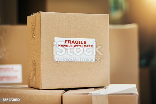 Still life shot of cardboard boxes marked as fragile and ready for delivery