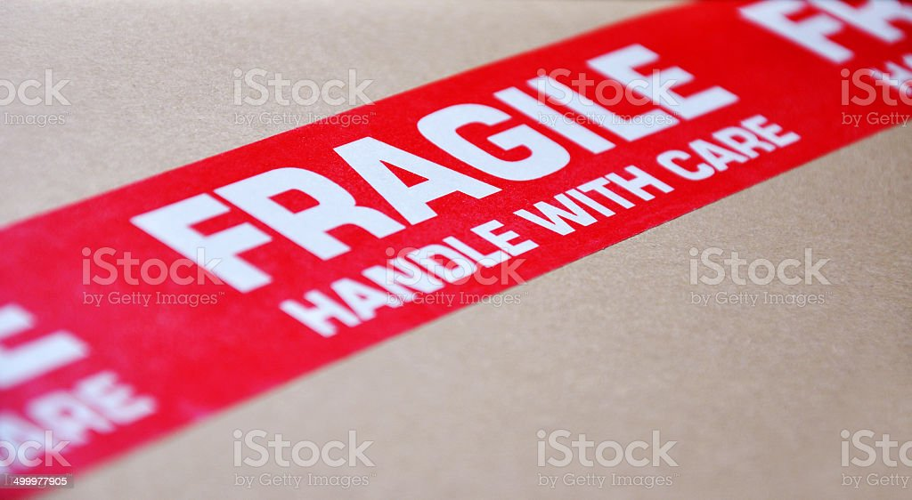 Fragile red label on a moving box stock photo
