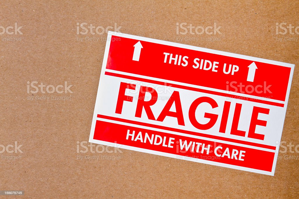 Fragile Sign on Cardboard Box stock photo
