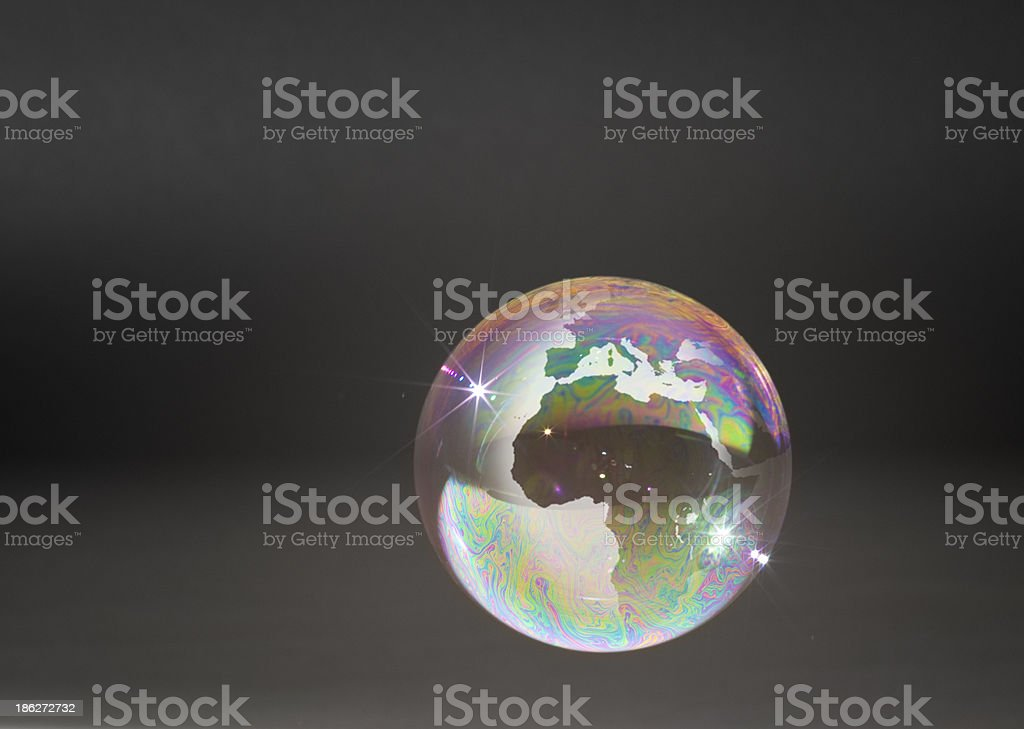 Fragile soap bubble Earth. stock photo