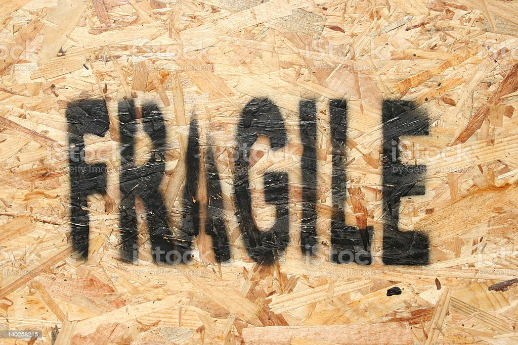 Fragile stencilled onto chipboard royalty-free stock photo