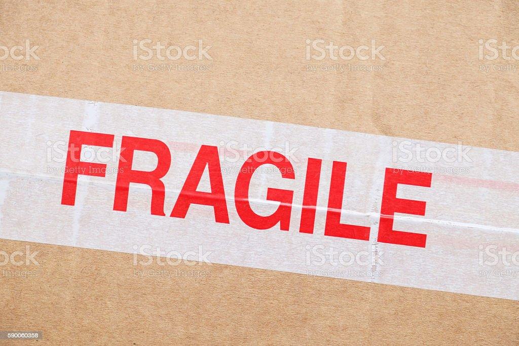 Fragile sticker on cardboard box stock photo