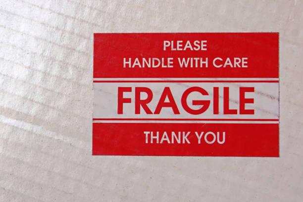 fragiele sticker - breekbaarheid stockfoto's en -beelden