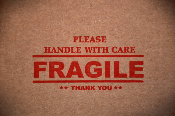 fragile warning sign label tag - fragile stock photos and pictures