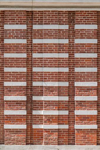 Fragment of a 18th century brick wall. Vintage bricks. Old wall.