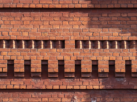 Fragment of a 19th century brick wall. Vintage bricks. Old wall.