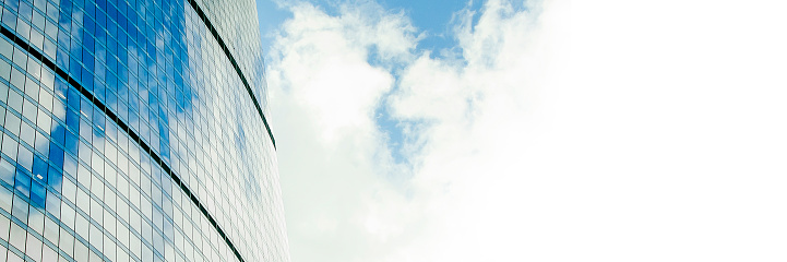 Fragment of a beautiful modern building against the sky. Panoramic banner with place for text, copy space.