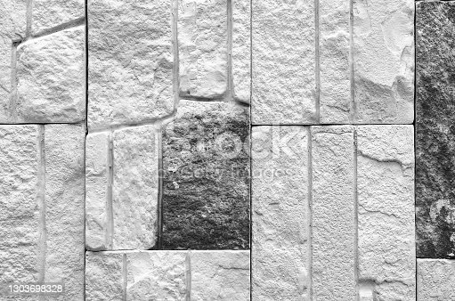 A fragment of a brick wall, black and white photography.