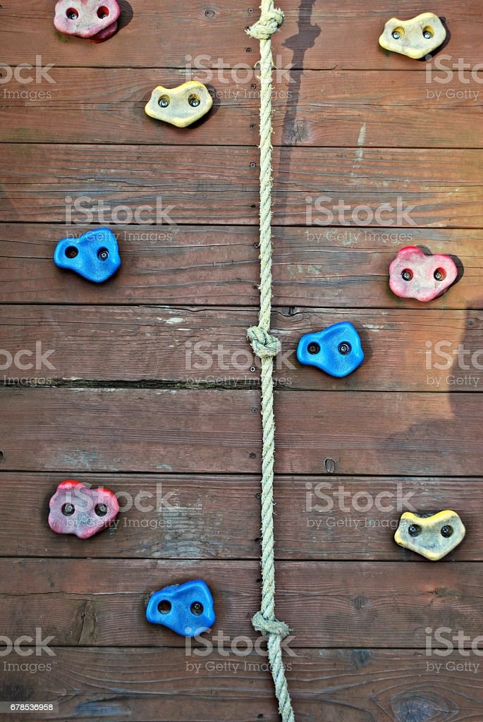 Fragment of a climbing wall on sky background stock photo