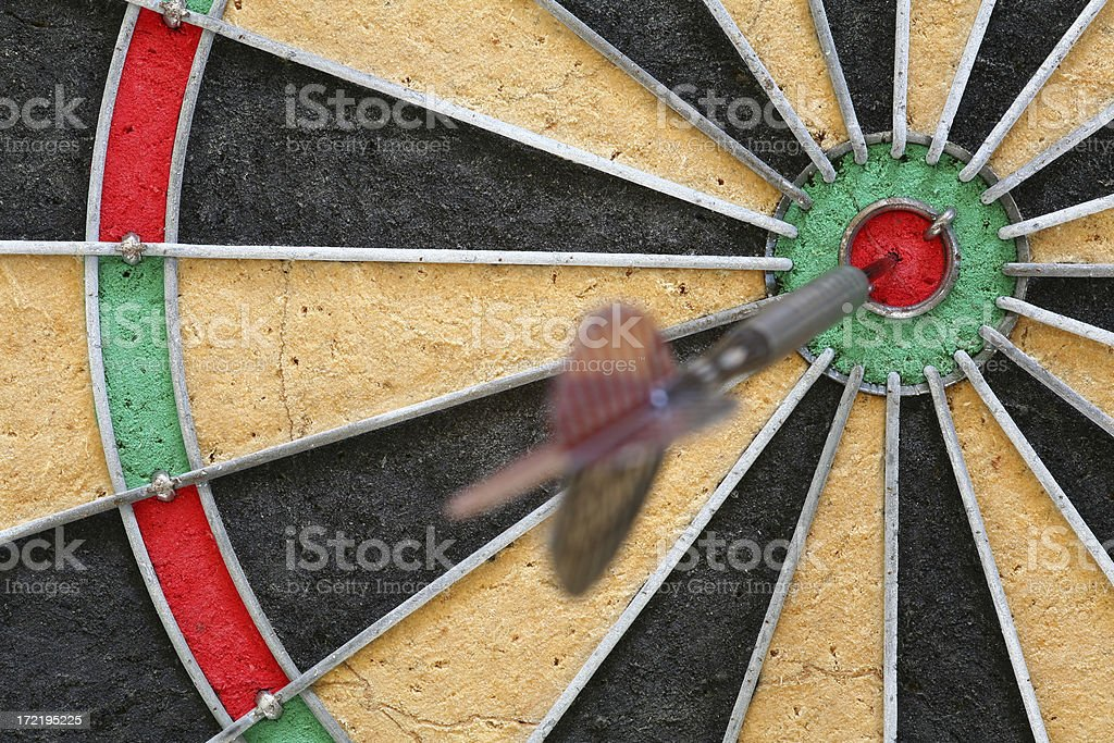 Fragment of a dartboard with dart inside the bull's eye royalty-free stock photo