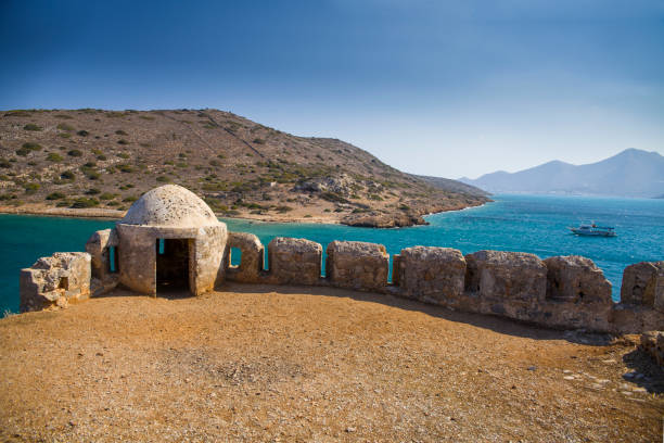 Fragment of a defense tower and walls in the Spinalonga fortress. Sea view from the leper island in Greece. – zdjęcie