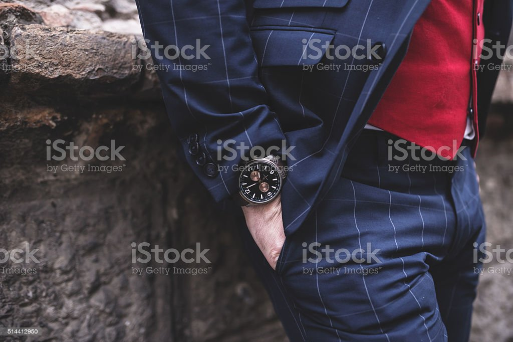 Fragment of a hand with a wristwatch, street style stock photo
